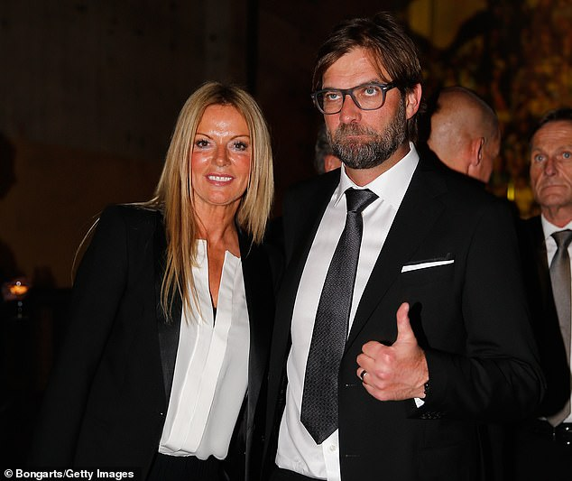 A teary Klopp (right) tried to call his wife Ulla (left) immediately after the title win was sealed